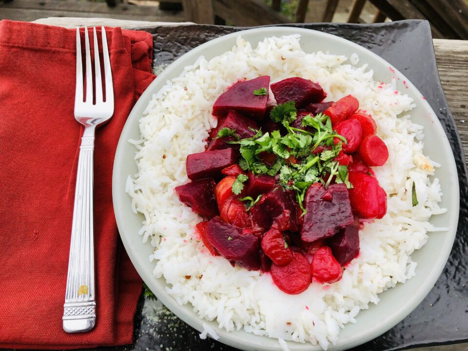 Beet Curry over rice with red napkin